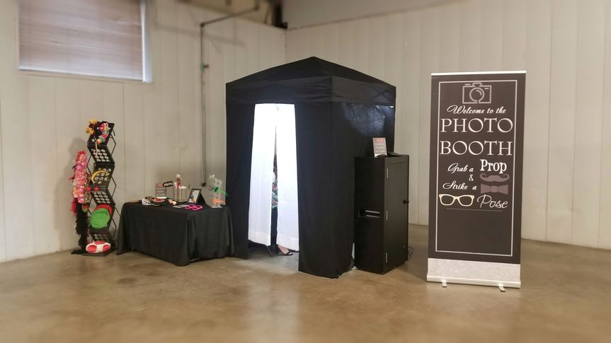 Pop up booth, signage, and props table set up for an event