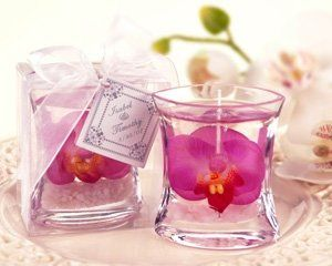 The simple beauty of a silk orchid suspended in gel in a sleek convex glass container is sure to...