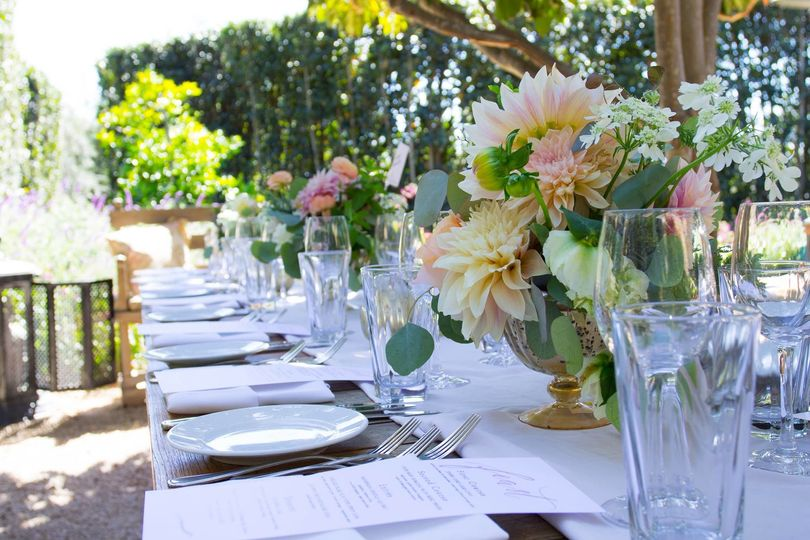 Long table setup with floral centerpiece