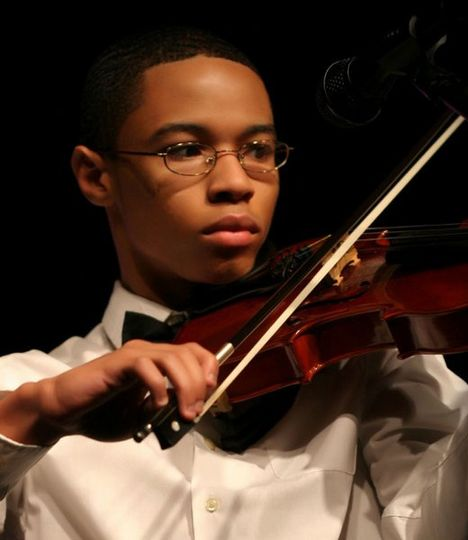 A violinist always adds a special touch of classical to an elegant ceremony.