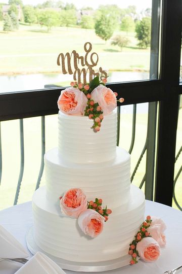 Peach & white wedding cake