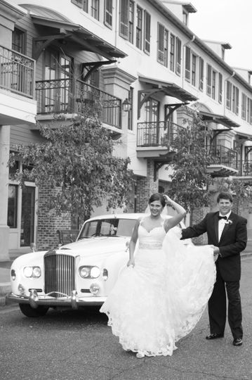 Groom holding the bride's dress
