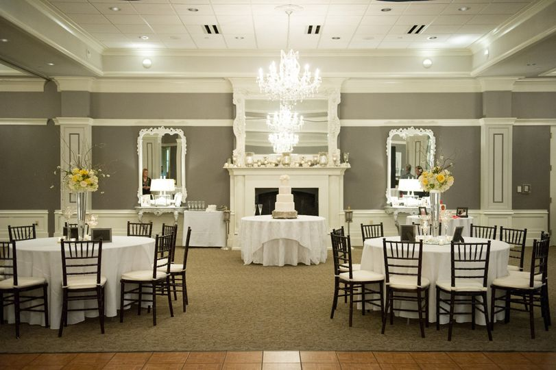 The fireplace and wedding cake table