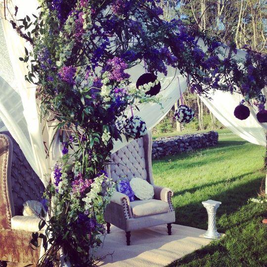 Violet floral wedding arch
