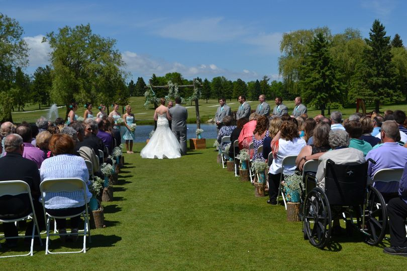 Outdoor wedding ceremony on Blue #1 at Fox Creek Golf Course