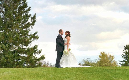 bride and groom picture on the golf course.