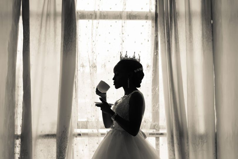 Bride drinking from her cup