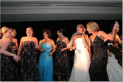Can you tell the female vocalist from the wedding party? Some brides like the band to be very...