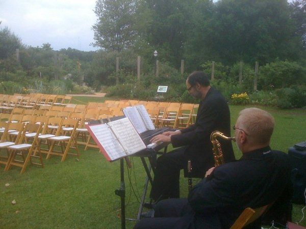 My guy's tuning up for the ceremony at Atlanta Botanical Gardens