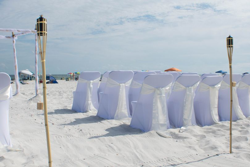 Spandex chair covers w/ champagne colored sashes... So elegant!