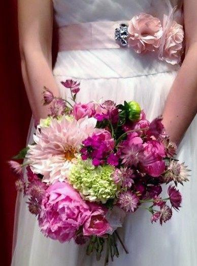 Bridal bouquet and pink floral belt
