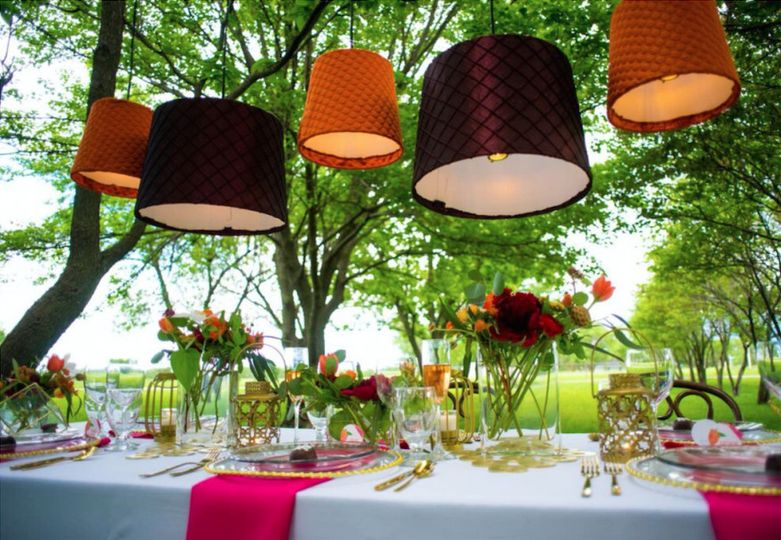 Outdoor reception table setup and decor