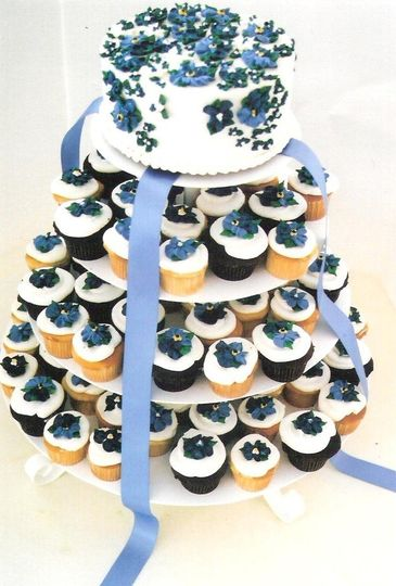 With a small, beautifully decorated round cake instead of the classic bride-and-groom topper, the...