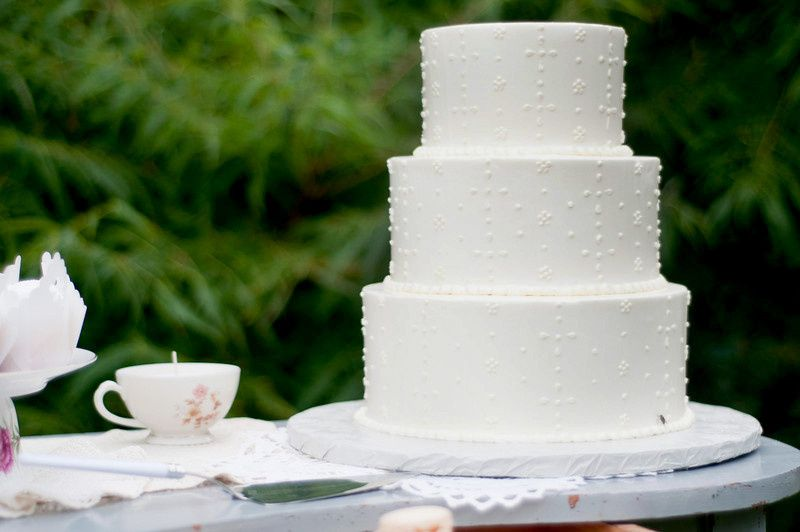 A classic three tiered cake with simple yet delicate lace decoration.