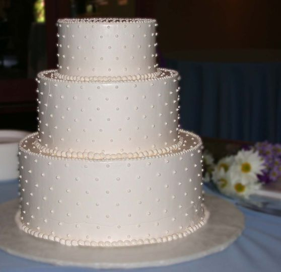 The classic white Swiss dots make for a simply perfect wedding cake!