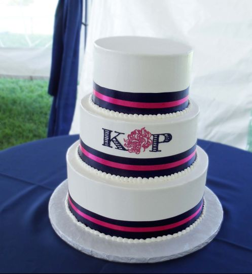 A monogram adorns this beautiful 3 tiered cake!