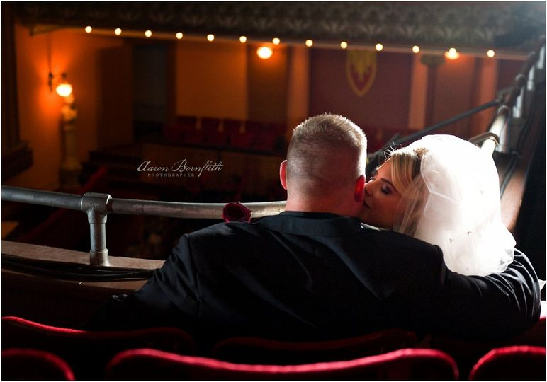 Bride and Groom in Theater Balcony