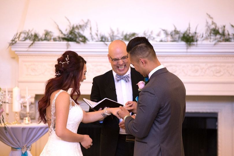 Happy officiant with the couple