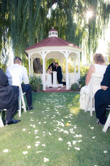Wedding ceremony at the Golf Course Gazebo. Photo by Michael David - Taltos Productions