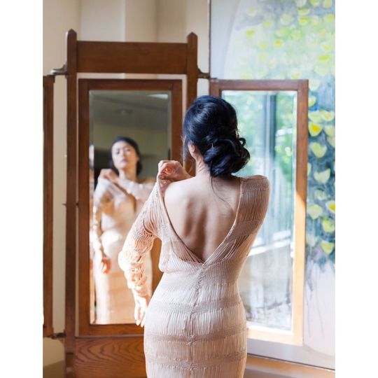 Kim on her wedding day. Kim is wearing custom made wedding gown in champagne color