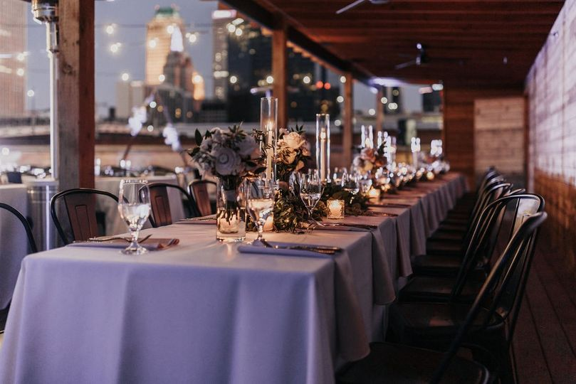 Head table bouquets candles