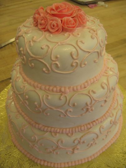 White wedding cake with pink icing