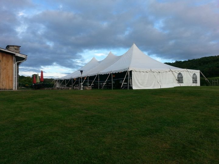 40x80 high peak set up for an autumn wedding with a solid and window walls and patio heaters