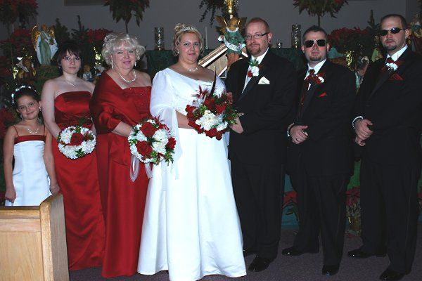 Couple with the wedding attendants