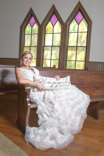 Bride sitting on the pew