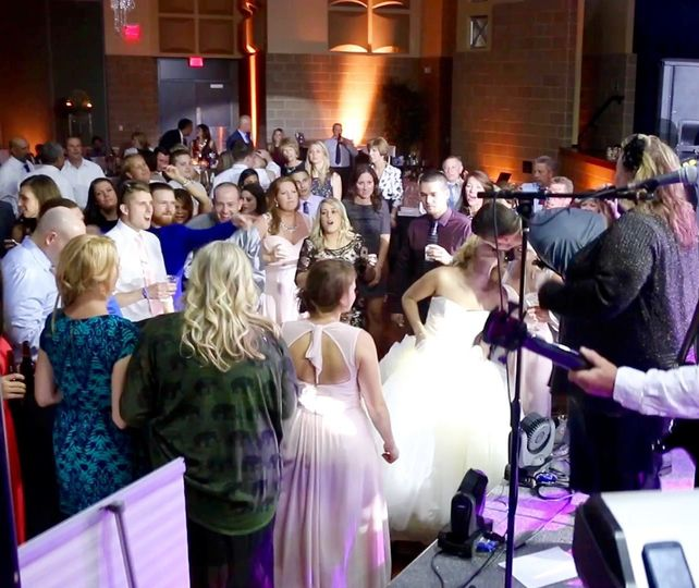 What a fairy tale wedding complete with a kiss from the stage.