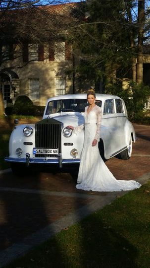 The bride besides the white car
