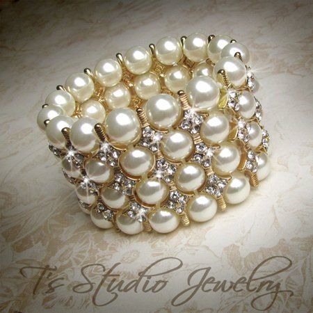 Dramatic Ivory and Gold Pearl Cuff Bracelet  This magnificent 4-row stretch wedding bracelet...