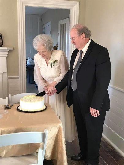 Couple slicing a cakeThe