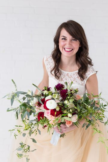 Bride holding the red roses
