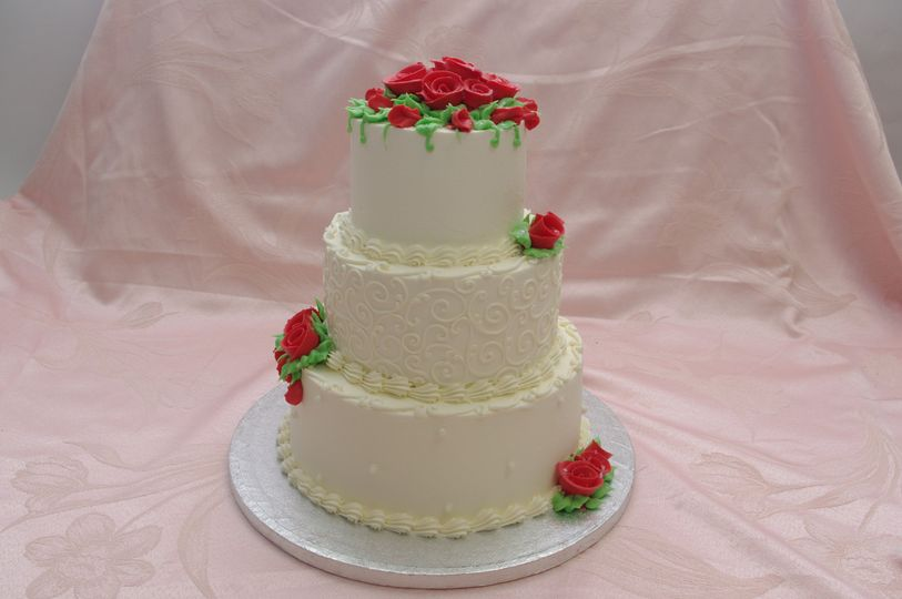 red roses and scrolls three tier