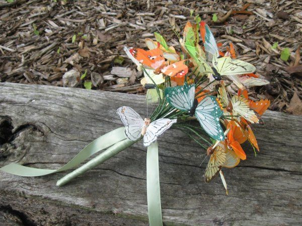 Artificial butterfly bridal bouquet.  orange, yellow, and green feather butterflies wrapped in sage...