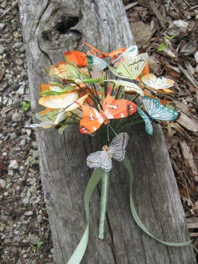 Artificial feather butterfly bridal bouquet in orange, green,and yellow.  Wrapped in sage green...