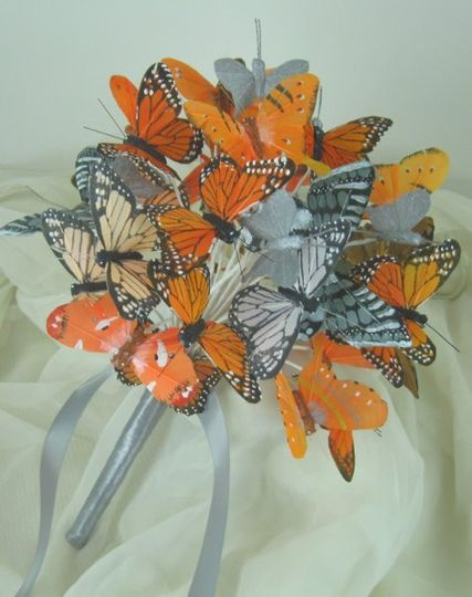 Custom made artificial butterfly bridal bouquet.  Made with various sizes of orange, silver, and...