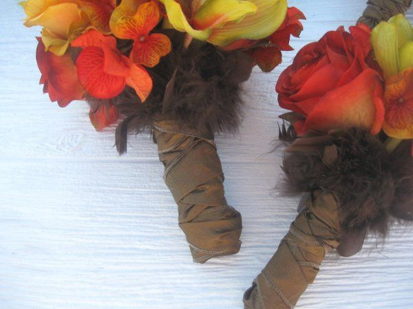 Bouquet stems with chocolate shimmer brown fabric ribbon with feather at top.