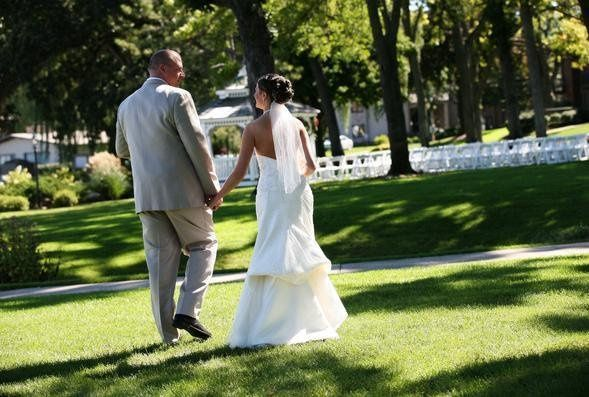 "A ""just married"" stroll on the Abbey harbor lawn."