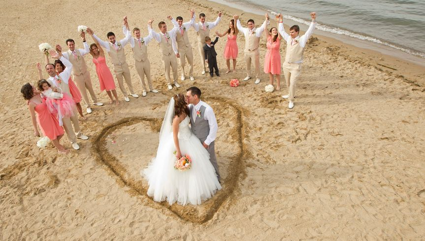 The Bride and Groom and bridal party enjoy the beach on beautiful Lake Geneva, WI.