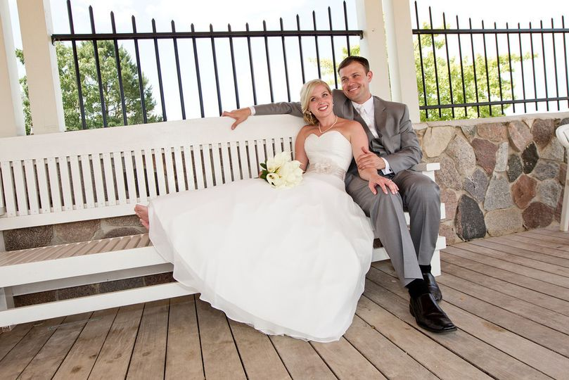 The Bride and Groom relax by beautiful Lake Geneva.