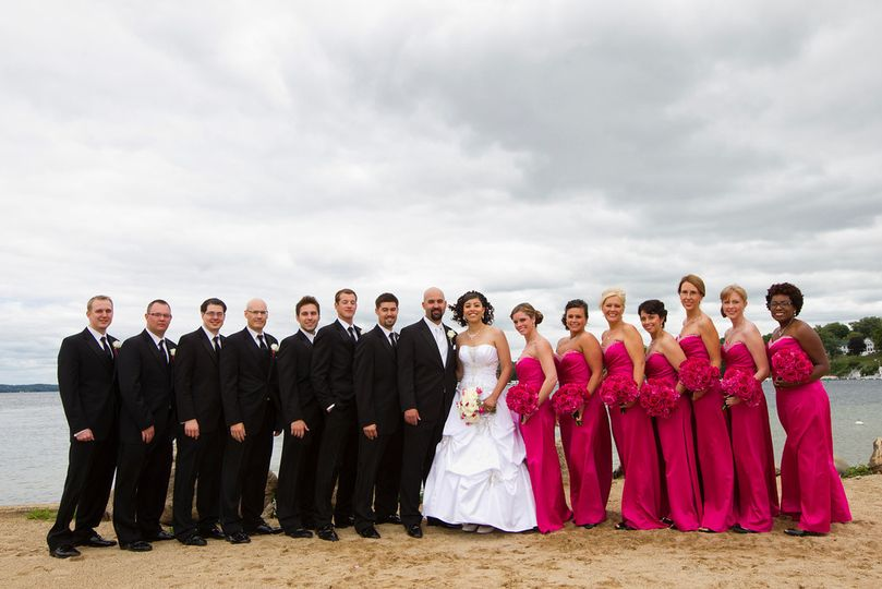 The Bride & Groom and entire bridal party pose by beautiful Lake Geneva.