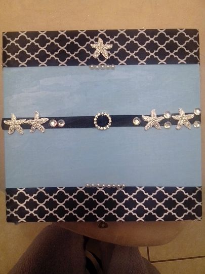 Blue keepsake box, with classic black and white patterned ribbon and diamond broaches