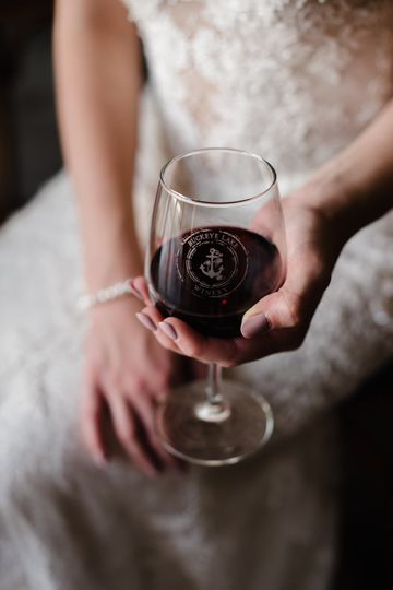 The bride holding her wine