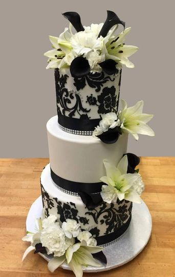 Stunning black & white damask cake with fresh flowers!