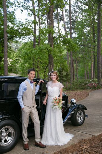 Newlyweds by the car