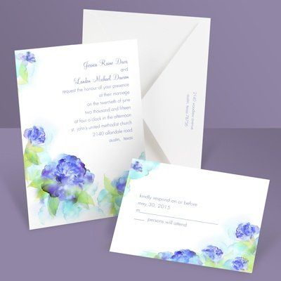 Heavenly - Invitation The watercolor flowers framing your wording on this white wedding invitation...