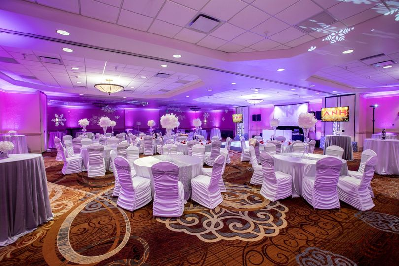 Purple uplighting with the tables set