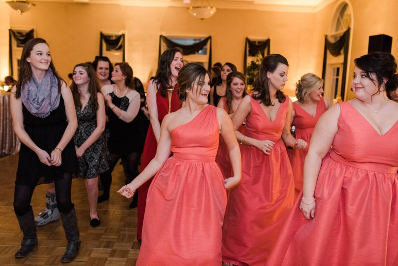 The bridesmaids dancing